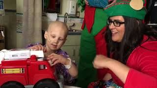 Mike and Nicole Deliver Toys to Kids at St. Luke