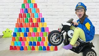 Ulya Pretend Play With Colored Cups and Wants to be a Policeman