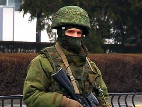 Ukraine's power struggle: Mystery gunmen storm Crimean airports