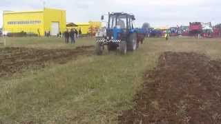 Борона дисковая БДМ 21х2 КС производства ООО БДТ АГРО с трактором Беларус 82