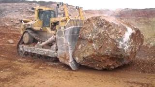 Caterpillar D11R pushing another massive rock