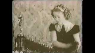 Shirley Temple presents Walt Disney a special Oscar