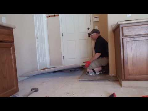 Pro Tip. Tear up an old vinyl floor using a palm nailer