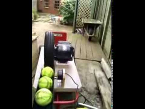 Home made slow-pitch softball pitching machine - trial in the garden