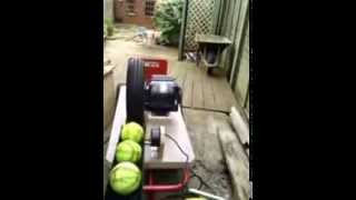 home made slow pitch softball pitching machine trial in the garden
