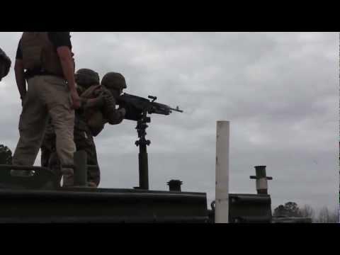 Marines Fire M-240 Machine Gun At Range From Boat Platform