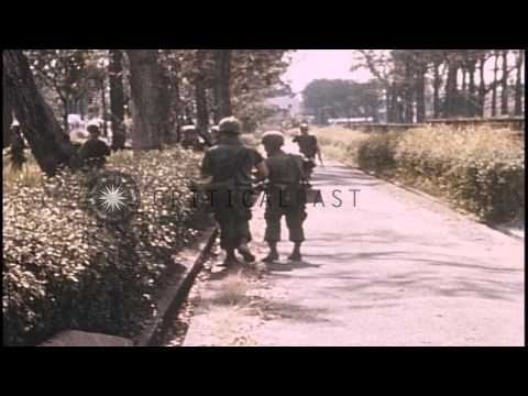 United States 1st Infantry Division soldiers search in cemetery at Saigon, South ...HD Stock Footage