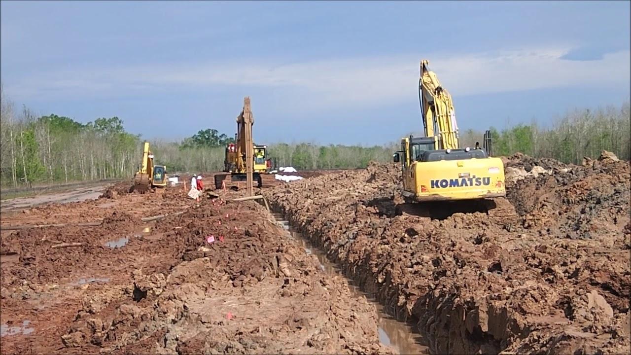 Soil-bentonite slurry trench cutoff wall construction