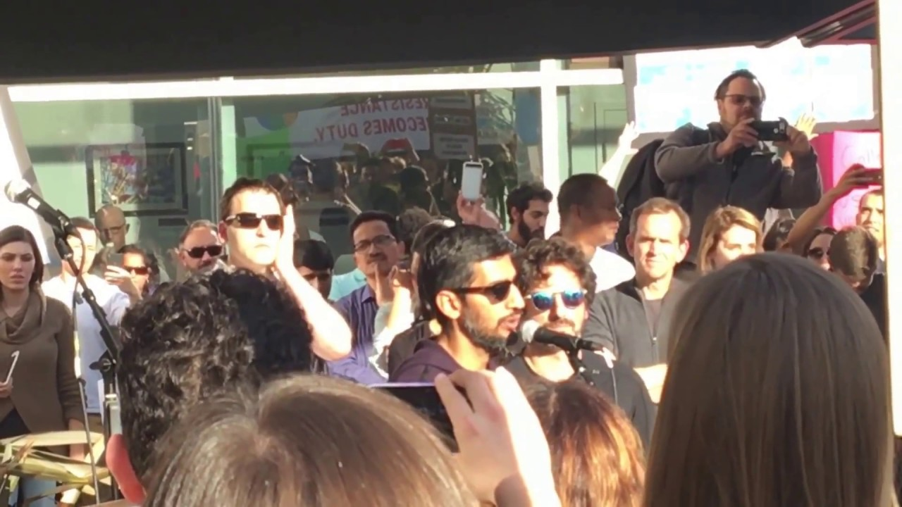 Sundar Pichai and Sergey Brin at Google employee rally against immigration ban