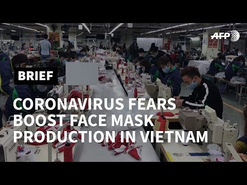 Vietnam mask factory ramps up production as virus fears mount worldwide | AFP