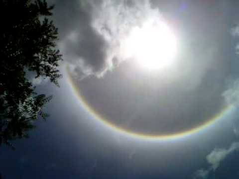 AMAZING RAINBOW APPEARS AROUND THE SUN (SHOT IN TRINIDAD)