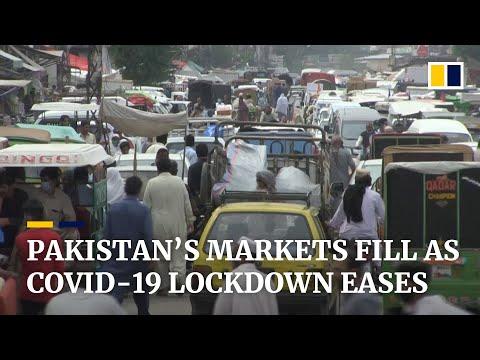 Coronavirus: crowds return to Pakistan's markets as lockdown eased despite rising case numbers