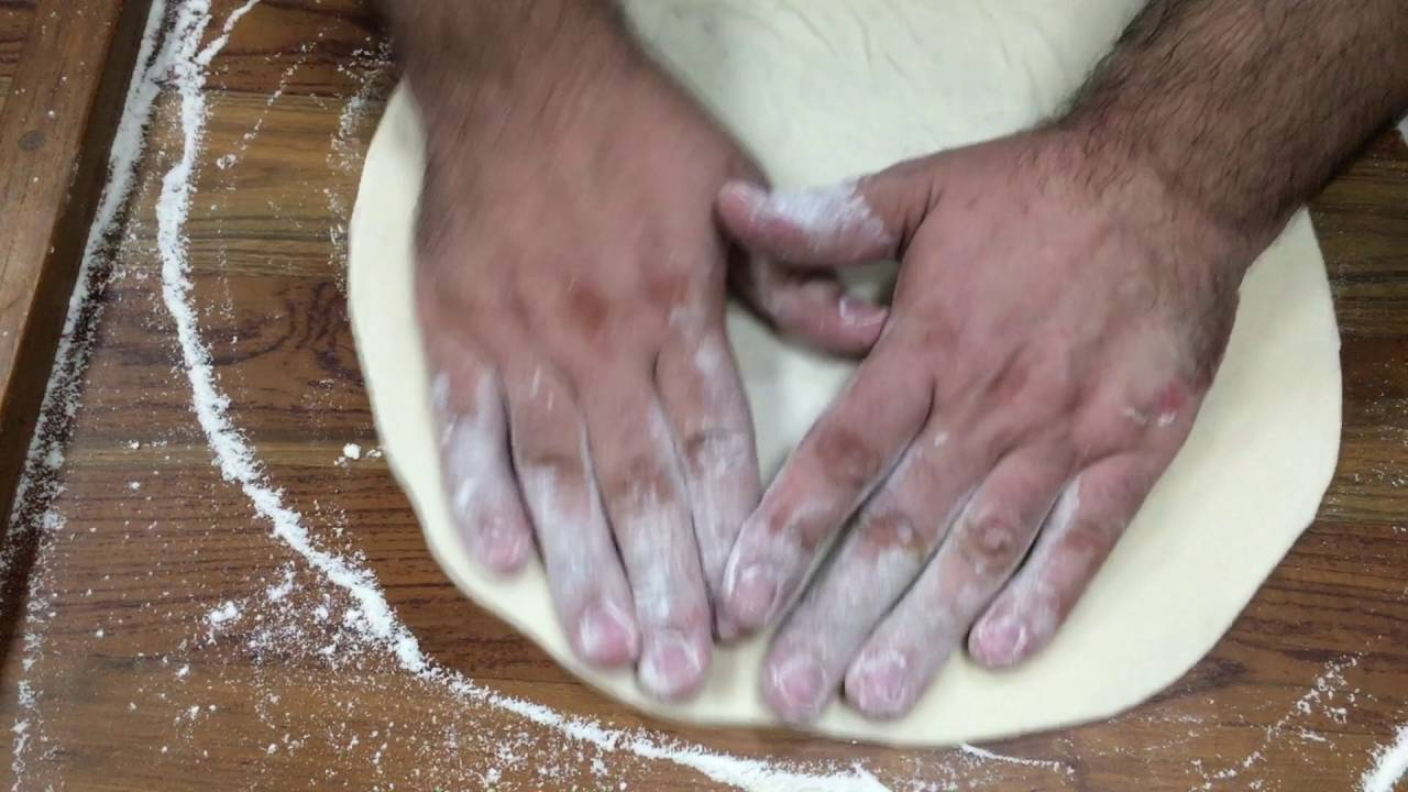 VIDEO RECIPE: How to stretch pizza dough by hand - YouTube