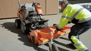 Learn how to attach a flail mower to a Husqvarna P 525D Front Mower