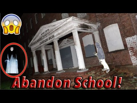 INSANE ABANDONED SCHOOL!! (WE SAW A GHOST!)