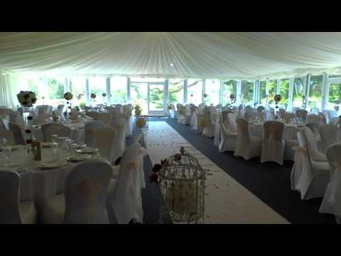 The Marquee at Nailcote Hall set up with a Mandap around the staging area