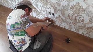видео Ламинат для теплого водяного пола, укладка напольного покрытия и подложки
