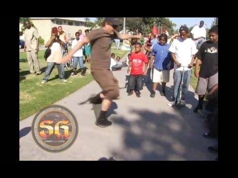 Stacy Peralta teaching skateboard tricks in the Jungles, South LA