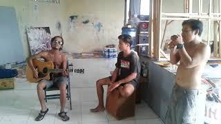 Pelukis pegang gitar  Batak vs Bali