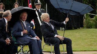 video: Watch:Boris Johnson struggles with umbrella at police memorial unveiling