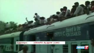 Passengers travel on the roof of overloaded train at UP spl hot tamil video news 13-10-2015