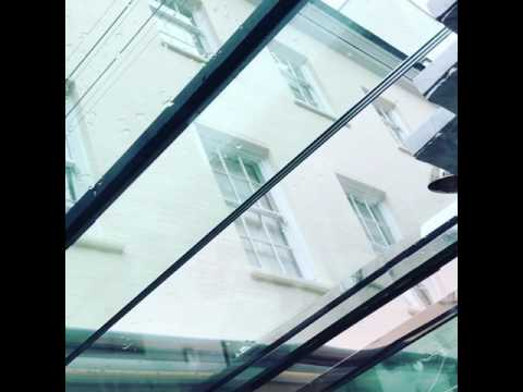 Sliding automatic glass roof by Architectural Vision Systems