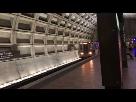 WMATA Orange Line trains arriving at the same time at Federal Triangle