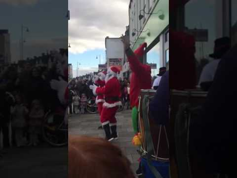 Indian Santa dancing to bhangra with Indian elves