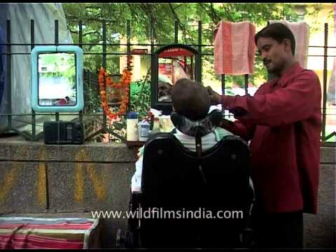 Road-side barber works the streets of New Delhi