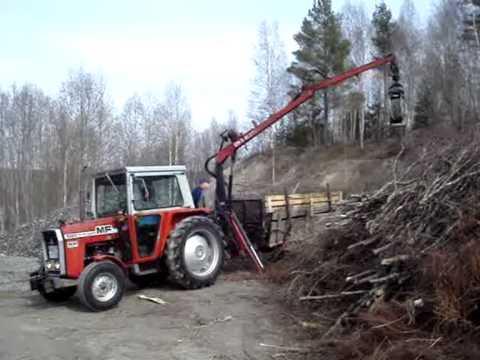 Massey Ferguson 550 unloading branches - YouTube