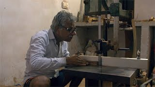 Tarkashi - A craftsman is cutting the piece of wood with machine