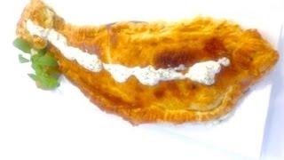 Праздничная рыба в нарядной шубке из слоеного теста.