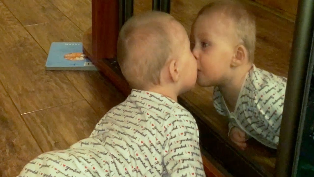 Funny Baby Sees Mirror. Funny child reaction. Baby in Mirror.
