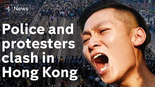 Hong Kong police fire tear gas at protesters after parliament chamber is stormed