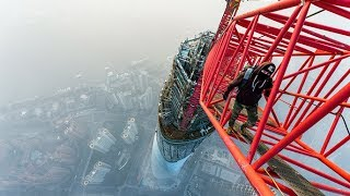 Breathtaking video: Daredevils skywalk world's 2nd-tallest tower in Shanghai(Scaling 121 stories of steel girders takes nerves of steel, as two unflappable daredevils - a Russian and a Ukrainian - recently proved by climbing Shanghai ..., 2014-02-14T20:08:36.000Z)