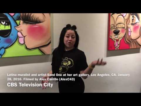 Latina muralist and artist Sand One speaking at her art gallery. January 28, 2016