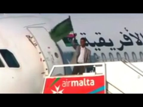 Man waves flag from hijacked plane