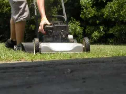 cutting grass with a Murray push mower