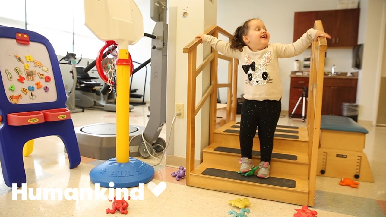 Little girl with spina bifida walks on her own   Humankind