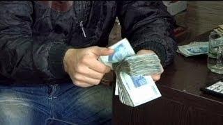 تراجع قياسي للعملة الإيرانية أمام الدولار