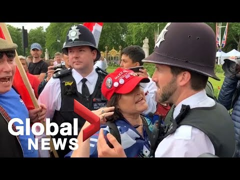 British police break up heated argument between Trump supporters and critic