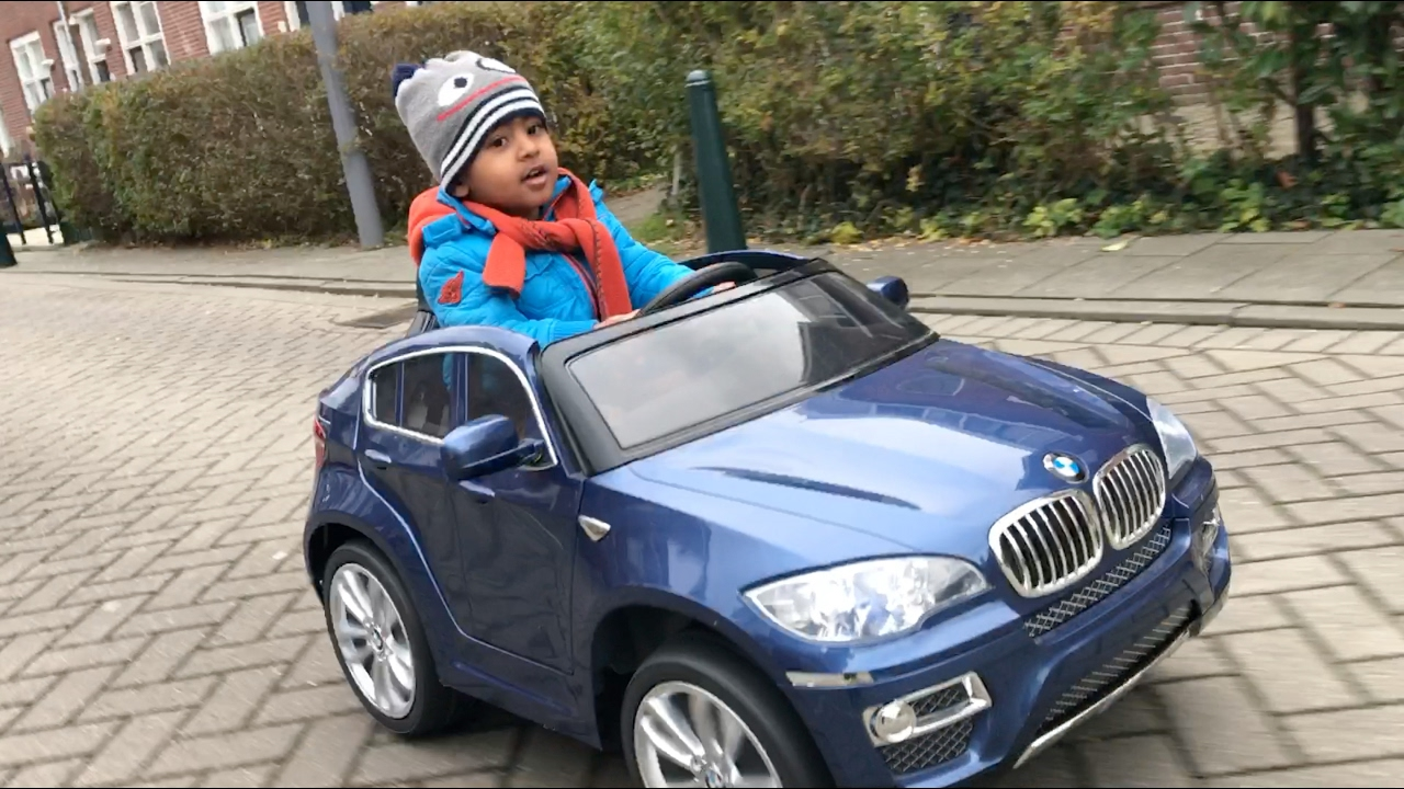 kids battery cars kid playing outside with bmw kids car on childrens ride on cars kid riding car