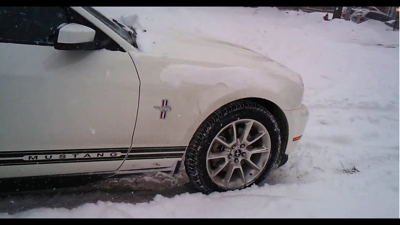 Ford Mustang in snow storm