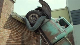 MONSTER TRUCK CHASE SCENE | DRIVING MONSTER TRUCK ON ROOFTOP SCENE FROM MONSTER TRUCKS IN REVERSE thumbnail