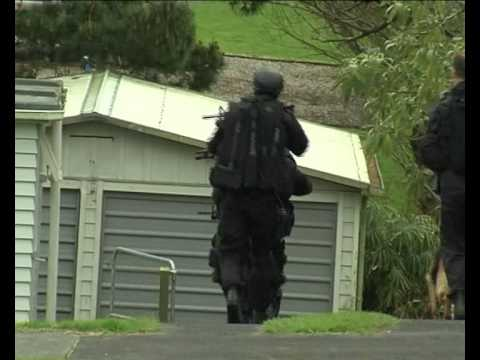 Cameraman attacked by police during armed alert in Auckland