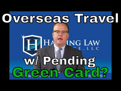 Will the immigration service let me travel overseas while my green card application is pending?