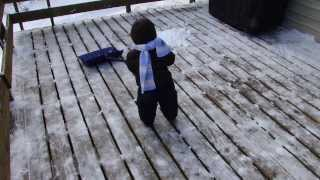 16 month old boy shoveling