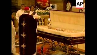 WRAP Cardinal Sin's coffin arriving at cathedral, mass, reax