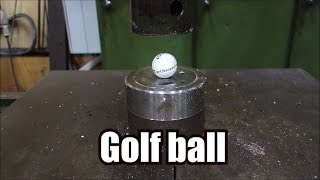 Crushing golf ball with hydraulic press