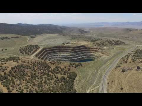 Drone's Eye View of Old Gold-Mining Town and Large Open-Pit Mines in Nevada